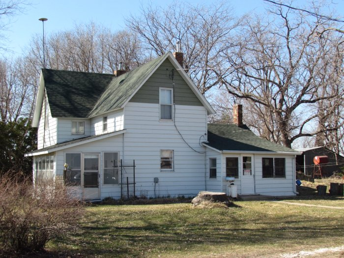 At Auction: 15.82 Acres with Cropland showing #100 CSR-2, along with 3 Bedroom Home, Barn, and Trees